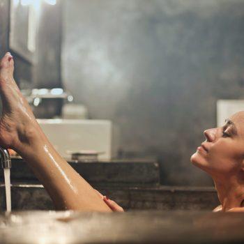 woman-on-gray-concrete-bath-tub-716437