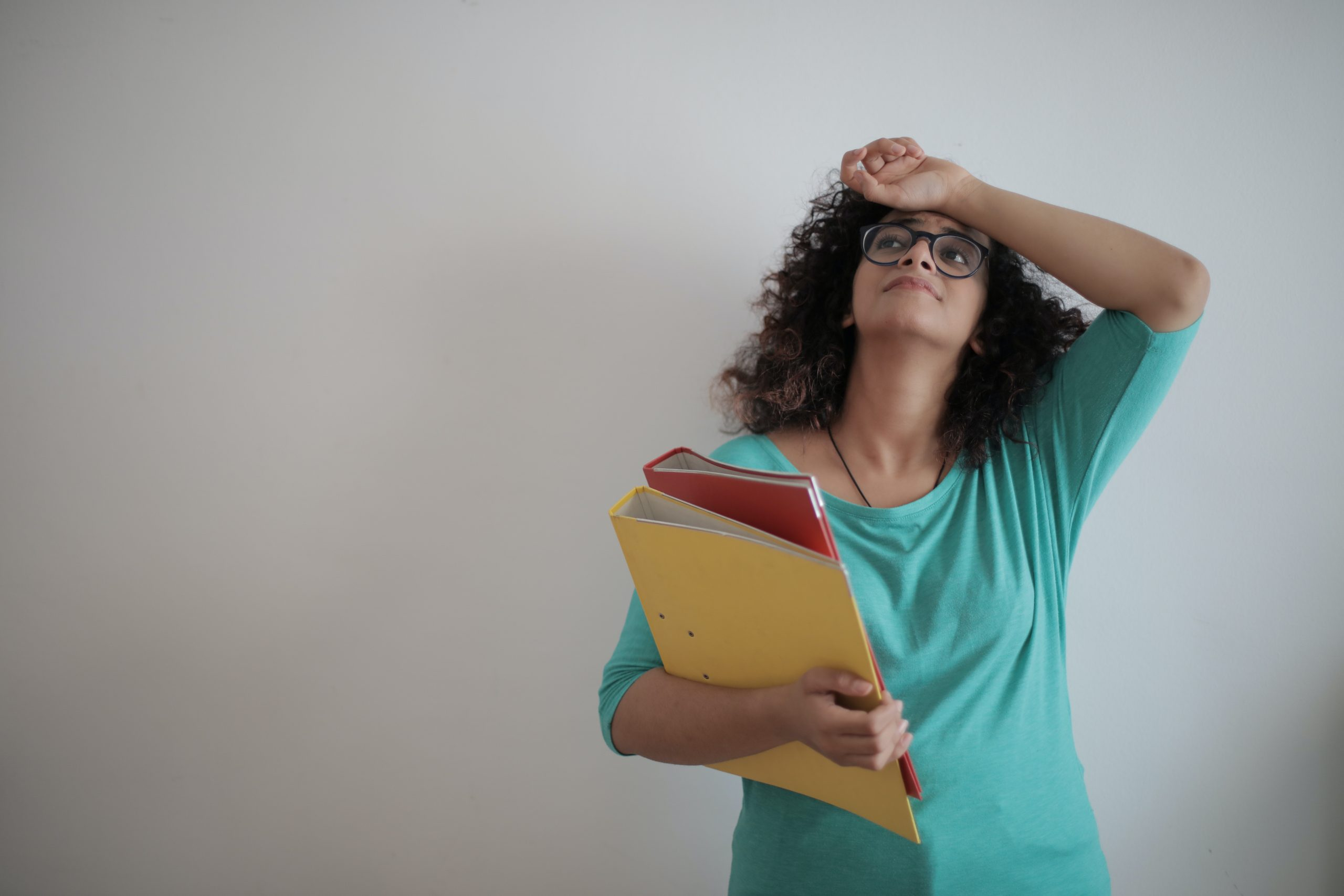 overworked-adult-female-entrepreneur-with-papers-in-light-3808819