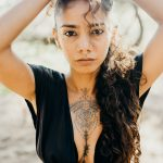 woman-in-black-sleeveless-top-4431055
